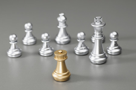 pawn king: Golden Rook with silver king, bishop, pawn on the background