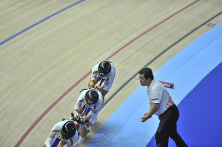 Nilai, Negeri Sembilan - February 17: Korea women junior team coach give instruction to the rider during women elite team pursuit finals of 38th Asian Track Championship 2018 at National Velodrome Malaysia, Nilai, Negeri Sembilan on February 17, 2018. Stock Photo - 95866841
