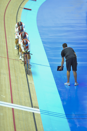 Nilai, Negeri Sembilan - February 17: Japan women elite team coach give instruction to the rider during women elite team pursuit finals of 38th Asian Track Championship 2018 at National Velodrome Malaysia, Nilai, Negeri Sembilan on February 17, 2018.