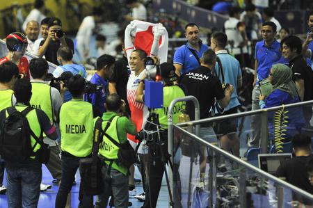 Nilai, Negeri Sembilan - February 17: Kawabata Tomoyuki of Japans rise the Japan flag after win mens Keirin finals of 38th Asian Track Championship 2018 at National Velodrome Malaysia, Nilai, Negeri S 에디토리얼