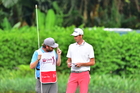 KUALA LUMPUR, MALAYSIA - October 11: Chesson Hadley(R) of USA talk to his caddie during 1st round of CIMB CLASSIC 2018 at TPC KUALA LUMPUR, KUALA LUMPUR, MALAYSIA on October 11, 2018. Publikacyjne