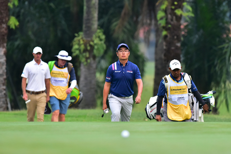 Kuala Lumpur - March 21: Wilson Choo (C) walk to the 10th green during Round 1 of Maybank Championship 2019, at Saujana  Golf & Country Club,  Kuala Lumpur, Malaysia , on March 21, 2019.