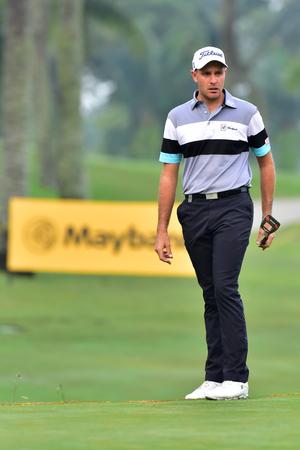 Kuala Lumpur - March 21: Jake Higginbottom of Australia watch his putt at 10th hole, during Round 1 of Maybank Championship 2019, at Saujana  Golf & Country Club,  Kuala Lumpur, Malaysia , on March 21, 2019. Editorial