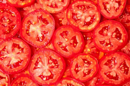 Healthy natural food, background. Tomatoes slices. More background of fruits and vegetables in my portfolio. 免版税图像 - 10282633