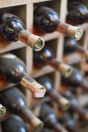wines: Dusty wine rack.  Stock Photo