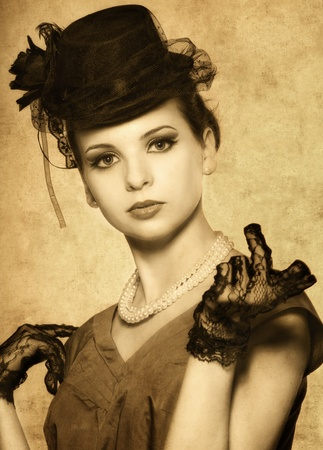 Vintage styled portrait of a beautiful woman photo