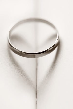 Wedding ring casting a heart-shaped shadow Stock Photo - 11860433