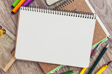 Notebook template mock up on a wooden table for artwork. View from above Stock Photo