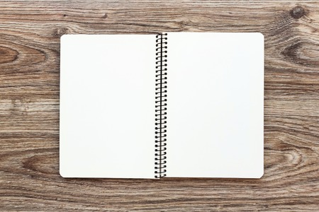 Mockup of open notepad with blank pages on wooden background. Template for your design. Top view.