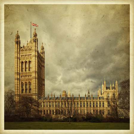 Westminster Abbey in London, England. Square vintage photo on old paper. 免版税图像