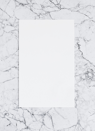 Blank sheet of paper on marble. Template of poster for lettering and design. Mockup
