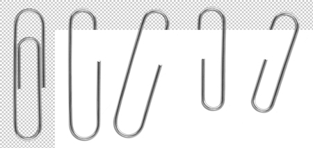 Classic metal paper clips isolated and attached to paper in different way.