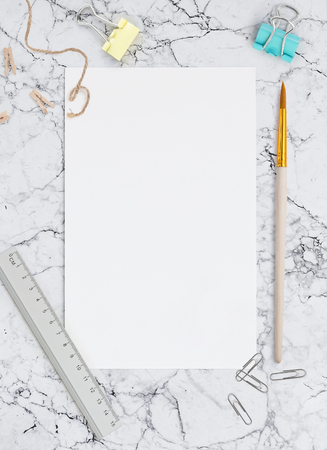 Blank sheet of paper on marble background. Template for calligraphy, letterings, design or all kinds of your art. Mockup for Social networks 免版税图像