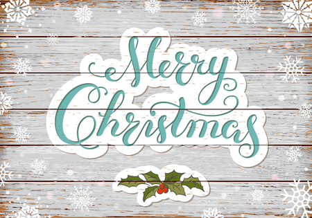 Calligraphy lettering Merry Christmas with hand drawn elements and snowflakes on old rustic black planks.