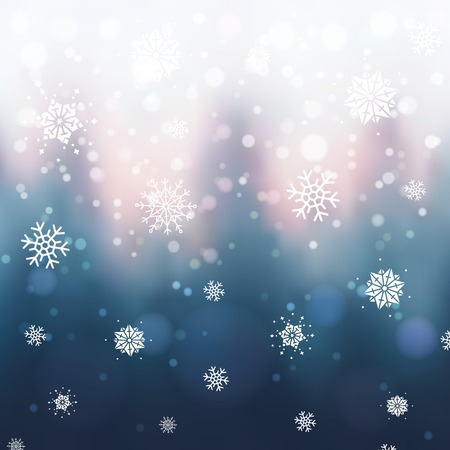 Abstract Christmas background with blurred winter forest, snowflakes and bokeh. Sunset or sunrise over winter trees.