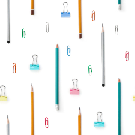 Flat lay with bright stationery supplies on white background. Seamless pattern. Back to school