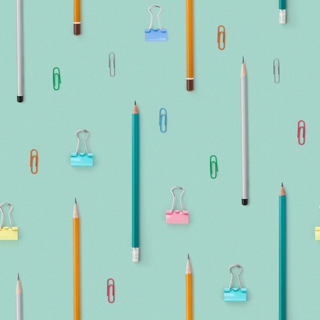 Flat lay with bright stationery supplies on blue background. Seamless pattern. Back to school 免版税图像