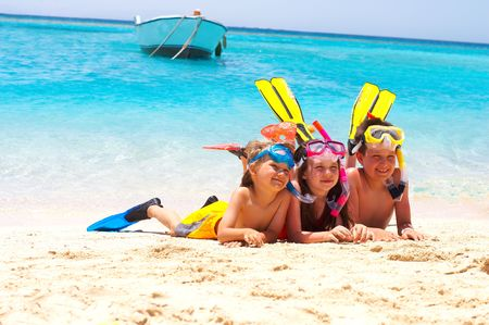 Happy Divers on a Beach Stock Photo - 1201759