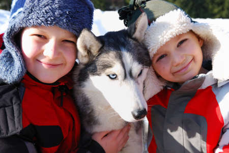 Children and husky dog Stock Photo