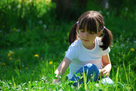 Girl sitting in the meadow