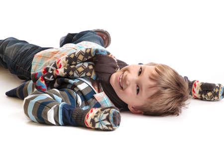 Smiling boy on white floor Stock Photo - 4615394