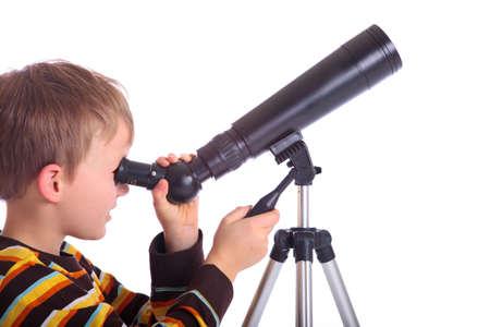 Boy with telescope Фото со стока