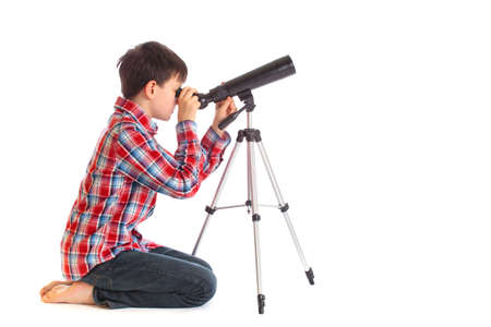 spyglass: Boy with telescope Stock Photo