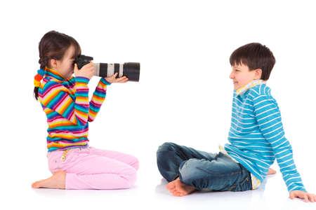 Girl taking a photo Фото со стока