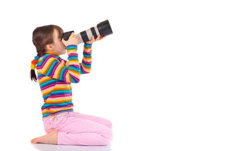 Girl taking photograph photo