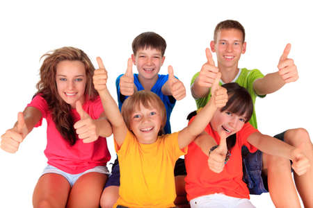 teenage girl happy: Teens and kids with thumbs up  Stock Photo