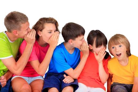 gossip: Gelukkige kinderen fluisteren Stockfoto