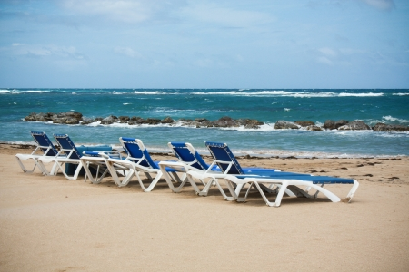 group of deckchairs on the calm beach Stock Photo - 22943756