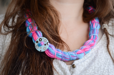colorful handmade necklace, brunette model photo