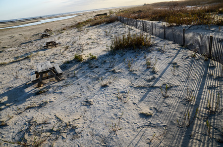 depressive: abandoned raw beach with long shadows