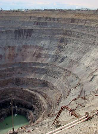 excavate:                Talakan,zemlyanye of work on a mine                 Stock Photo