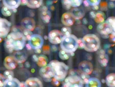 Seamless abstract background with soap bubbles in the air. Blurred defocused artistic style for your design, wrapping papers, prints, web page etc. Banco de Imagens