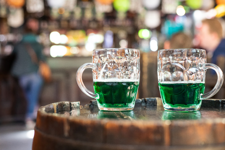 St. Patrick's Day - two glasses of green beer in a pub