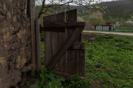 old wooden fence collapses near the house