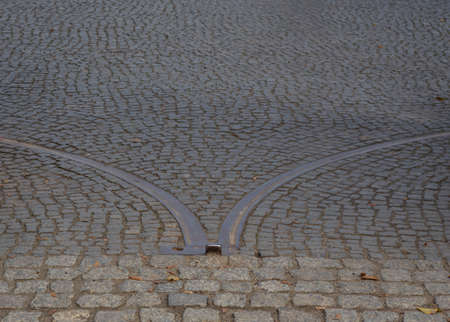 old granite cobblestones close up lined with an arc