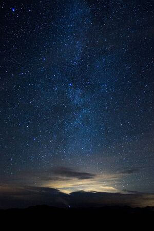 Beautiful photography of star night in the blue sky with milky way in the background Standard-Bild