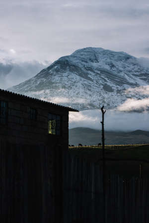Beautiful mountain behind a house with sunlight