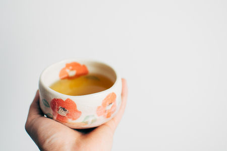sencha: Green Japanese Sencha tea in hand