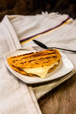 Typical colombian food arepa choclo Colombian cuisine made of ground corn and white cheese, another version of the Cachapa with cheese, Typical Venezuelan cuisine