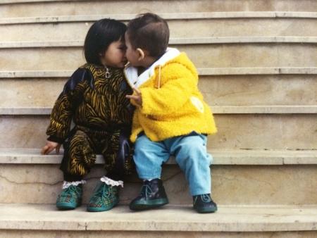2 kids telling secrets Stock Photo
