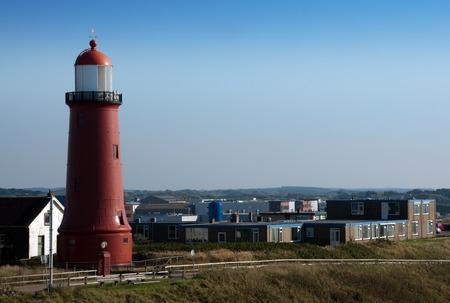 ijmuiden: lighthouse in the harbor of the city IJmuiden Stock Photo