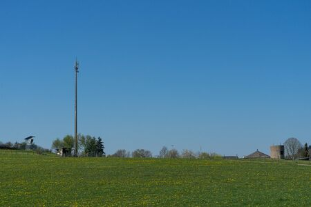 5G Cell tower on framing field with blue sky