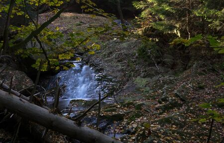 Time exposure of a river called Ilsefaelle in the german region Harz Stockfoto - 131585973