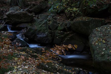 Time exposure of a river called Ilsefaelle in the german region Harz Stockfoto - 131586179