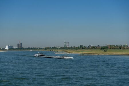 Freighter on the river rhine in the summer Stockfoto