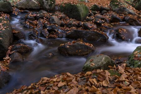 Time exposure of a river called Ilsefaelle in the german region Harz Stockfoto - 131586590